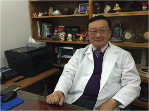 "Dr. Liu displays all the gifts he has received from his patients on his bookshelf, including the troll doll which he calls ""kind of ugly."""
